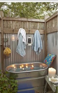 Outdoor bathtub! Perfect for a summer cabin vacation home.