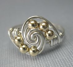 Mixed Metals Wire Wrapped Gravitation Ring by holmescraft on Etsy