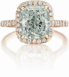 A Fancy Light Bluish Green Diamond Ring.