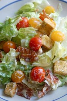 "A ""BLT"" salad - bacon, lettuce and tomato. :-) The dressing absolutely makes this salad! It is so de-li-cious!  Recipe adapt..."