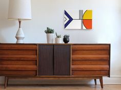 Balance -Mid century modern - vintage modern - geometric canvas wall art.  The Balance series is printed on a bright white background with black line details and features blue, deep orange and vintage yellow.