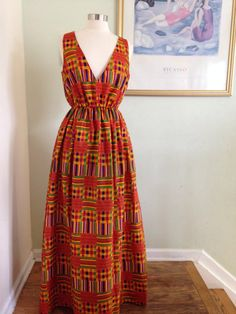 Maxi dress with Kente Cloth Print - Colored as above - V neckline - Elastic waist - Floor length dress - Dress has pockets - top of dress and skirt are lined - length is approx 60 inches but can be customized - This dress can be made with any fabric in my store. Questions? Please convo me :-)