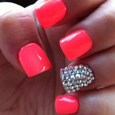Neon Coral paired with a single blinged out nail | this color looks like it could be China Glaze Flip Flop Fantasy or Shocking pink