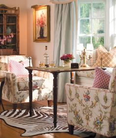 sweet and quaint!...love the curtains.
