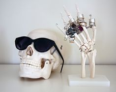 Mad love for this skeleton hand ring holder!  And the idea of the skull sunnny holder?  Freaking genius.
