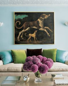 Aqua and green accents in a light blue living room-just get rid of the dog picture (I'm keeping that comment because YES, gross picture.)