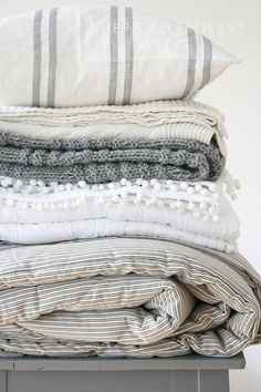 Grey and white pillows and blankets for a dreamy, relaxing bedroom.