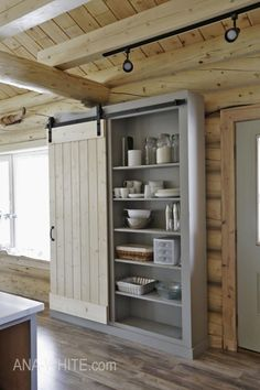 #DIY Barn Door Pantry tutorial. Love this #farmhouse style by Ana White!