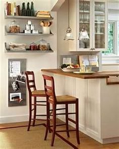 glass door cabinet above breakfast counter