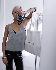 Hola from the @thpshop.co office in something fuzzy and grey // THP cuffs, #THPLab tank top, Coach moto pants, THP tote #thpshopco #THPobjects ✌️✌✌