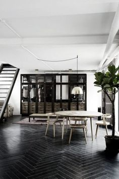 black floor Bright industrial home with black wood floors, a gold pendant light, and a walk-in closet Industrial House, Industrial Interiors, Industrial Furniture, Industrial Stairs, Industrial Windows, Industrial Restaurant, Industrial Apartment, Industrial Bedroom, Industrial Office