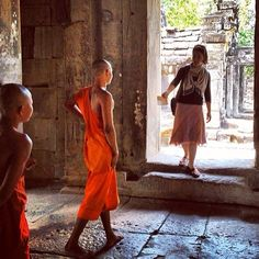 """jw_witnesses @khmerterry tells us: """"This is in Siem Reap, Cambodia. Kim and I were doing return visits today near this 11th century ruin called Wat Atwea and these young monks came up and spoke to us (unusual as monks usually don't speak to females) so Kim gave them a Memorial invitation.""""  See date, times and places around the world at JW.org"""
