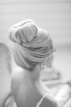 Cute bun!!! A little flower clip on the side would be adorable to dress it up; but it's perfect with or without!!