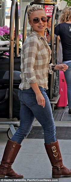 Country girl: Hayden Panettiere was spotted leaving her hotel in New York City in a checked shirt, jeans and brown boots today