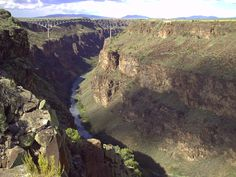 The Rio Grande Gorge runs from northwest to southeast of Taos, New Mexico, and cuts through the basalt flows of the Taos Plateau volcanic field. The Taos Gorge is known for its world class white water and steep pocketed rock climbing, as well as its hidden hot springs that flank the river for miles.