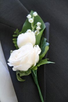 The Bride Groom's rather special Boutonniere of fresh Lily of the Valley with a small white Peony and a Bombastic Rose Bud