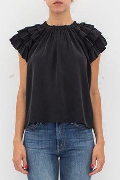 """- 100% Silk - Ruched jewel neckline - Short sleeves - Picot-edge ruffles - Slips on - Color: Black - Model is 5'9"""" and wears a size US 2."""