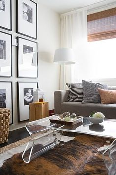 Black and white picture frames and layered rugs