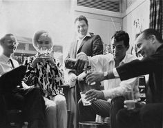 """Wally Cox, Marilyn Monroe & Dean Martin celebrating her 36th birthday on the set of """"Something's Got To Give"""" 1962."""