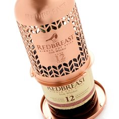 Our latest creation for Redbreast is a beautiful pack in its own right, but truly comes alive once the whiskey bottle has been removed. This clever aluminium bottle holder doubles as a hanging bird feeder, and was created as part of a charity campaign with BirdLife International Irish Whiskey Brands, Hanging Bird Feeders, Pot Still, Packaging Manufacturers, Luxury Packaging, Bottle Packaging, Bottle Holders