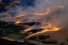 Ranchers burn the Flint Hills of Kansas to get rid of the old, dry growth for the new Spring grass. State Of Kansas, Kansas Usa, Oklahoma, Kansas City, Manhattan Kansas, Flint Hills, Land Of Oz, Home On The Range, Great Plains