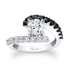 Black+Diamond+Engagement+Ring+-+7737LBKW+-+This+unique+black+and+white+diamond+engagement+ring+features+a+white+gold+split+shank.++A+prong+set+round+diamond+center+is+cradled+in+the+open+center+and+one+band+sports+black+diamonds,+while+the+other+is+adorned+with+white+diamonds+for+a+dramatic+effect+that+is+nothing+short+of+spectacular.+    Also+available+in+18k+and+Platinum.