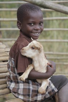 4 year old Frank holds the family goat. Zambia, photo credit: Heifer International