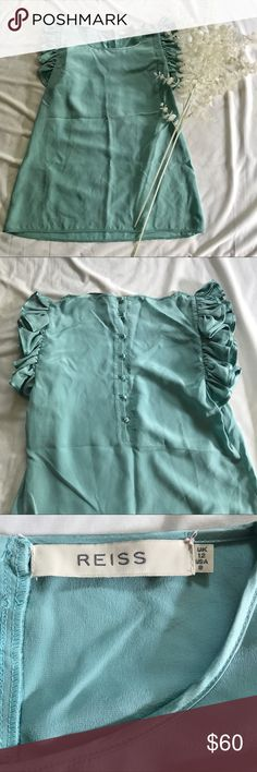 Reiss • Ruffle Silk Shell This top is the most beautiful shade of robin's egg blue! Ruffles are on trend right now, and the button details on the back of this piece make it even more adorable. Excellent condition, 100% silk. Reiss Tops