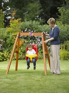Plum Wooden Baby Swing Ideal swing set for young toddlers to enjoy outdoor play time in the garden! This baby swing set uses soft feel ropes and an injection moulded baby seat with a high back and harness straps for extra safety. The premium FSC® cert Baby Swing Set, Wooden Baby Swing, Wood Swing, Swing Sets, Outdoor Baby Swing, Diy Swing, Porch Swing, Outdoor Toys For Kids, Kids Outdoor Furniture