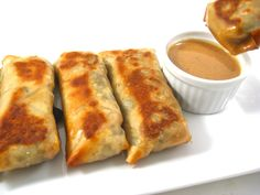 """Skinny Baked Vegetarian Egg Rolls with Peanut Sauce. """"Meatless Mondays"""" or any day of the week never tasted so yummy with these baked egg rolls! Each has 117 calories 3 grams fat and 3 Weight Watchers POINTS PLUS. Ww Recipes, Veggie Recipes, Great Recipes, Vegetarian Recipes, Cooking Recipes, Favorite Recipes, Healthy Recipes, Cleaning Recipes, Cooking Tips"""
