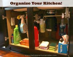 Clever under-sink idea -- hang a small tension rod to hang spray bottles on -- freeing storage space on the bottom of the cabinet. From The Happier Homemaker.