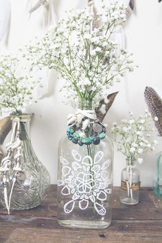 Paint mason jars with paint markers would cute as a shabby chic vase