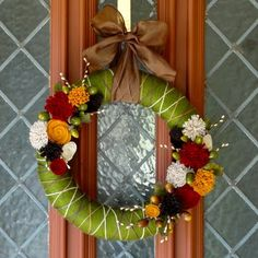 I love these colors!  YARN FLOWER WREATH  by Lauren's Creative  Simple felt and yarn with a few other craft store items created this adorable wreath perfect for decorating your door this fall! I'm partial to that fabulous green color so this one is absolutely my FAVE!