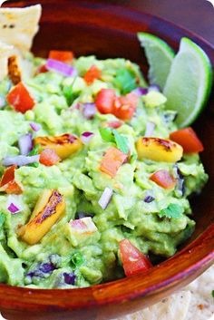 Vegan/GF/Vegetarian - Grilled Pineapple Guacamole - made with smoky, sweet grilled pineapple chunks, avocados, tomatoes, red onion, jalapeno pepper, cilantro, fresh lime juice, kosher salt & pepper. Serve with a pile of tortilla chips and an ice cold margarita!