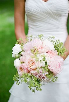 For her bouquet, the bride carried her favorite flower: white and blush-colored peonies laced with lady's mantle and roses, and tied with ivory