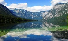 lake bohinj slovenia However, as much as I enjoyed Lake Bled, Bohinj was better.  Just a thirty minute drive away, Lake Bohinj loses all the crowds, feels more Slovenian and less touristy, and is home to a lake that shimmers with just a hint of green.