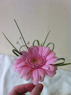 Single Pink Gerbera buttonhole with foliage and pearls