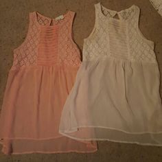 Tank tops Two very cute tanks. Both have a cute lave top and a flowing bottom. Has a cute design down the middle of top and a key hole in the back. NWOT BONGO Tops Tank Tops