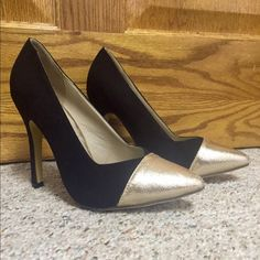 """NWOT Black Cap Toe Pumps Never worn. Size 7.5, fits true. Black faux suede with metallic textured gold cap toe- perfect for a holiday party! 4.5"""" stiletto heel. A few scratches can be found on insole of left pump. Come with extra heel replacements. Purchased at Nordstrom Rack a few months ago. Jacobies Shoes Heels"""