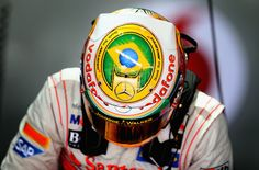 Lewis Hamilton of Great Britain and McLaren wears a specially designed helmet giving thanks to his team as he prepares to drive during practice