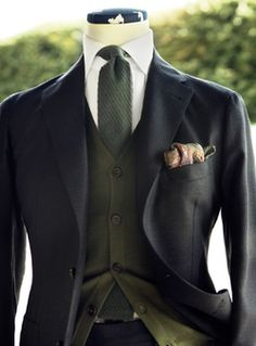 A great pocket square... A cream white is better than pure white.