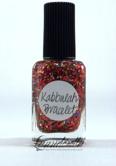 Kabbalah Bracelet. Red string. And multi-coloured holo hexes. Works almost like the bracelets. Ask Madonna. Sheer red base with bleeding glitter.