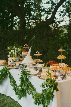 Outdoors Cake + Dessert Table, homestyle, greenery garland; by Bash Please, photo: Our Labor of Love
