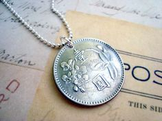 Hey, I found this really awesome Etsy listing at http://www.etsy.com/listing/93949826/orchid-coin-jewelry-vintage-1970s-one