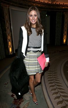 in a geometric-print sweater, pleated Milly skirt, colorblocked Tibi blazer, and red-trim pumps at the Temperley London show (2013)