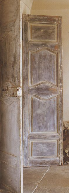 Loving the charming, old doors used as decor elements these days. These well-traveled doors reside in a Sydney, Australia home, but origin...
