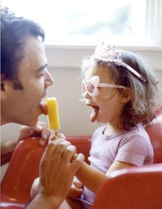father daughter love. I remember eating Popsicles with with my dad--the kind that came as two and you broke them apart. I always requested cherry or grape.