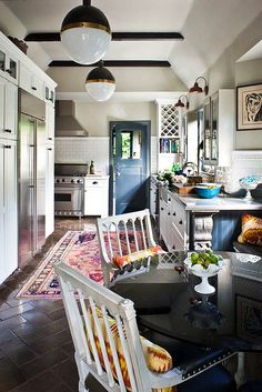 tia zoldan kitchen high gloss magazine. If you have a kitchen with an old fluorescent lighted ceiling here is a way to make it look better. Love the angled ceiling and beams.