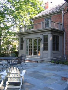 slate and brick patio, raised stone patio Glencoe Private Residence 2 - traditional - exterior - chicago - COOK ARCHITECTURAL Design Studio Traditional Exterior, Modern Exterior, Exterior Design, Exterior Houses, Exterior Trim, Cafe Exterior, Stucco Exterior, Modern Roofing, Exterior Paint Colors For House