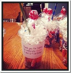 these birthday cups are fun! fun! The bottom has candy with paper shred on top, pencil stuck out like a straw and a blow-pop for the cherry on top. Just precious!